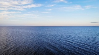 A calm sky over the rippling waters of Lake Winnipeg at Chalet Beach
