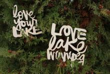 Wooden ornaments featuring Kal Barteski's script