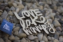 """Letters carved out of wood. They read """"Love Lake Winnipeg."""""""